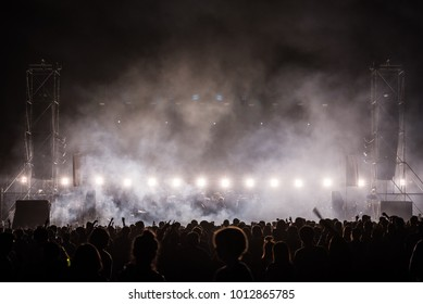 silhouette concert crowd with concert light