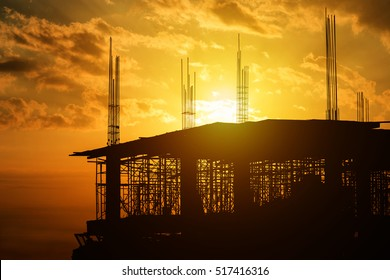 Silhouette of construction building site city urban skyscraper on sunset background