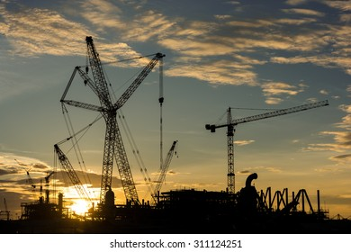 silhouette construction Industry oil rig refinery working site, asia in Thailand