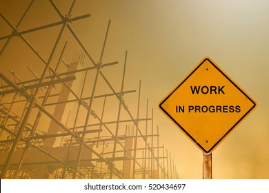 silhouette of construction with message work in progress