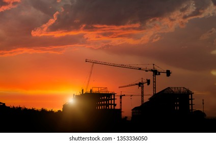 Silhouette construction site with beautiful sunset sky background. Abandon building with sunset background.