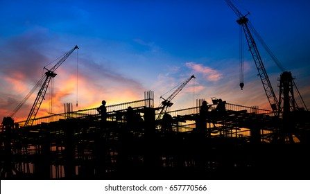 Silhouette of the construction site on sunset background