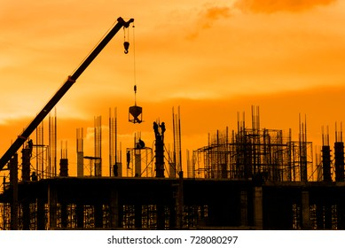 Silhouette construction site on sunset in evening time.Engineer and worker on building site.