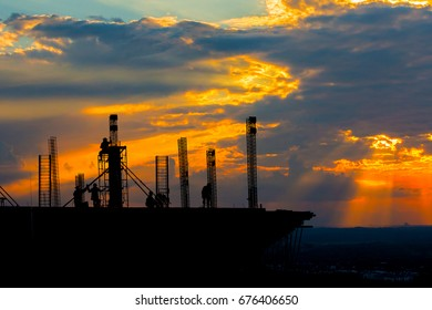 silhouette construction site team on sunset time background