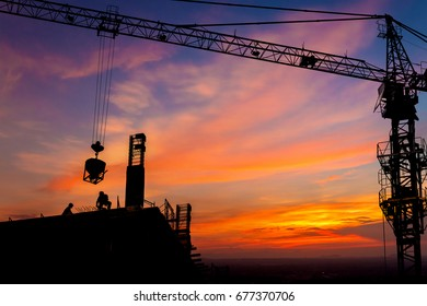 silhouette construction site team working on sunset time background