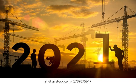 Silhouette construction site,Cranes building construction 2021 year sign - Shutterstock ID 1789875647