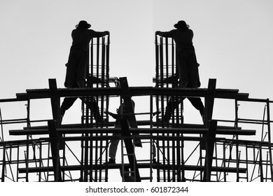 silhouette construction team working on high ground over blurred background
