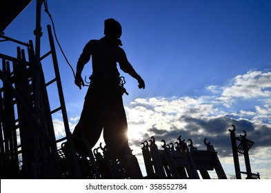 "silhouette of construction worker, Japanese steeplejack ""Tobi"": early in the morning"