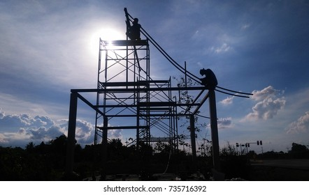 Silhouette of Construction Worker on Construction Site