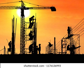 Silhouette construction workers group are working to build reinforcement structure on top of building in construction site with blurred sundown sky background in technology and industrial concept