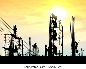 Silhouette construction workers group are working to build reinforcement structure on top of building in construction site with blurred sunrise sky background in industrial concept
