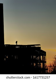 Silhouette of construction working at sunset