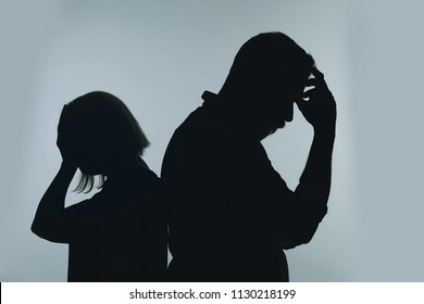 Silhouette of couple having argument on color background. Relationship problems