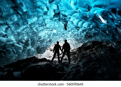 Silhouette of couple in ice cave
