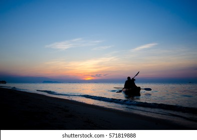 Silhouette couple kayaking on the sea with a beautiful sunset background, silhouette sunset samui Thailand,