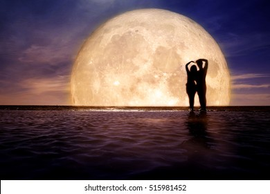 Silhouette of couple love with full moon background - Elements of this image furnished by NASA
