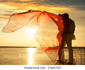 Silhouette of couple in love on sunset background