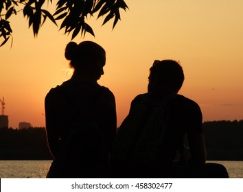 Silhouette couple in love at sunset.
