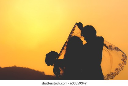 Silhouette of couple in love at sunset.