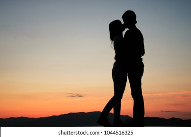 Silhouette of a couple loving each other