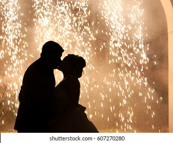 silhouette couple of newlyweds kissing while dancing on the dance floor celebrating valentines day