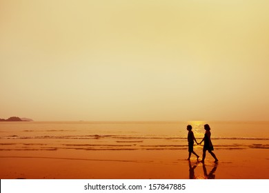 silhouette of couple on the beach, man and woman