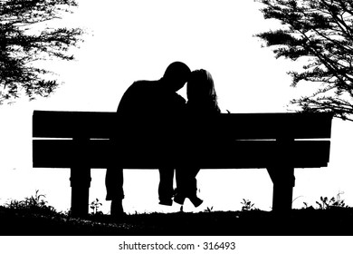 silhouette of couple on park bench