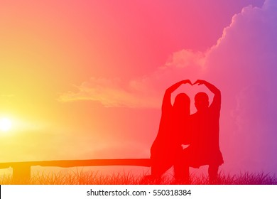 Silhouette couple sitting on a wooden chair, Valentine day idea.