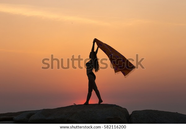 silhouette of couple at sunset summer, yoga concept.