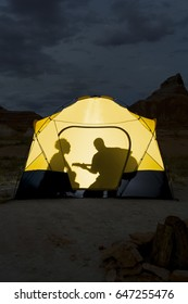 Silhouette of couple in tent
