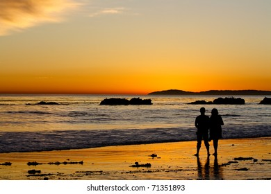 silhouette of couple watching sunset