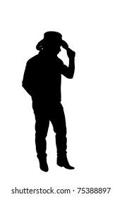 The silhouette of a cowboy which holding his hand on his hat. Isolated on white.