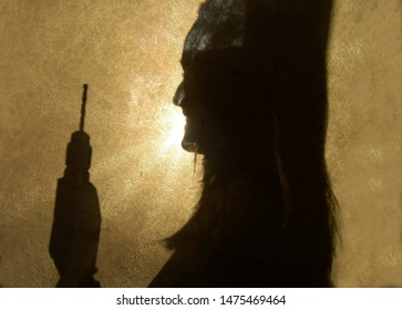 silhouette of a craftswoman holding a drill