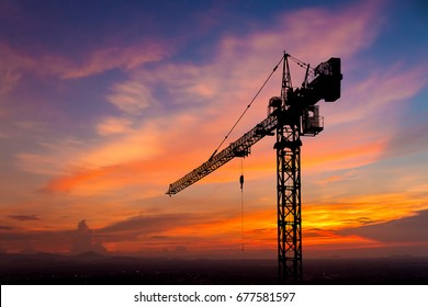 silhouette crane construction site on sunset time background