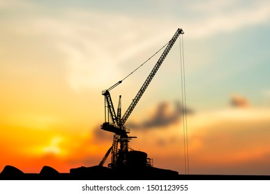 silhouette crane with sunset background