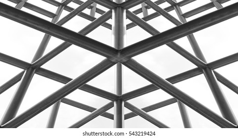 Silhouette of crisscrossing metal scaffolding frame.