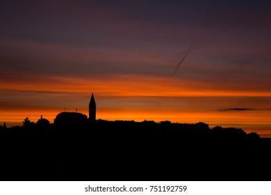 The silhouette of the Croatian coast town Vrsar at dawn
