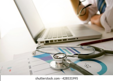 Silhouette of cropped shot of doctor hand working with new modern computer and medical concept