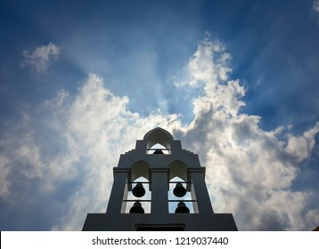 The silhouette of the cross and church bell tower in sunrise.Church against sunrise.