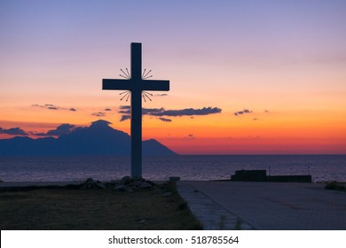 Silhouette of cross and mount Athos at sunrise or sunset and sea panorama in Greece