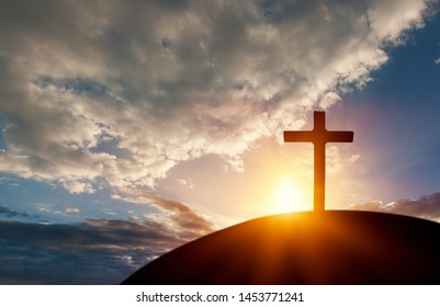 Silhouette cross on Calvary mountain sunset background. Easter concept          - Image