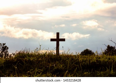 Silhouette cross on mountain at sunset background.Crucifixion Of Jesus Christ