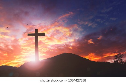 Silhouette the cross on sunset background