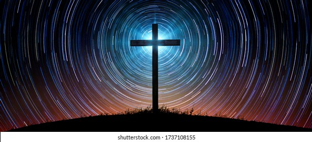 The silhouette of the cross as a symbol of the Christian religion against the background of the night sky with tracks of stars. Concept on the theme of God, paradise, religion,  Religious background.