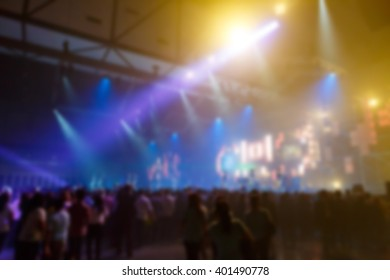 silhouette crowd in front of concert stage blurred