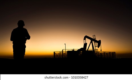 Silhouette of crude oil pump and oilfield worker