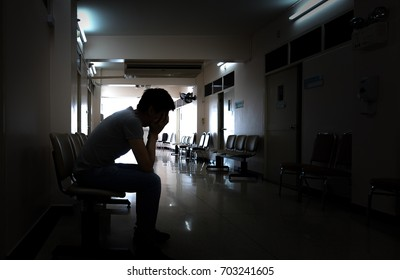 Silhouette of a crying man waiting for his wife or family in the hospital about emergency accident or Deadly disease