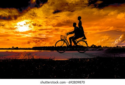 Silhouette of cyclist in motion on the background of beautiful sunset.