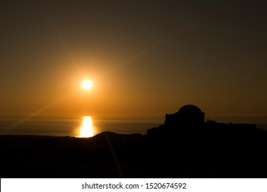 silhouette of dammuso (typical ancient construction) at sunset in pantelleria island, sicily