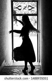 Silhouette of dancing girl in coridor .Black and white .